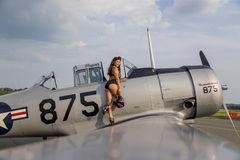 Model and WWII Piston Airplane Stock Photo