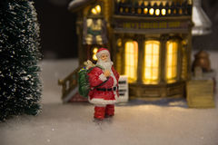 Model Xmas Village, santa in the snow. Santa in the snow, postcard, christmas card, model village stock photo