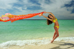 Model in yellow bikini holding pareo Royalty Free Stock Images