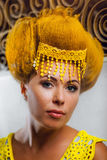 Model in a yellow cloth. The portrait. Stock Image