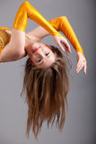 Model in yellow shine dress hang down Stock Images