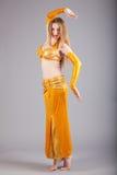 Model in yellow shine dress pose Stock Photo