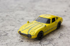 Model of yellow sports car. Toys: model of yellow sports car Royalty Free Stock Photos