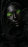Model z czarny twarzą. Zdjęcia Royalty Free