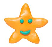 Modelando a estrela de sorriso da argila foto de stock royalty free