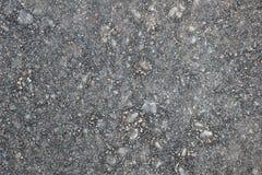 Modele la textura del asfalto viejo con las pequeñas piedras Imagen de archivo libre de regalías