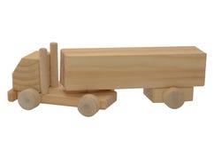 Modele un camión con un remolque de la madera Fotos de archivo