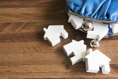 Modelhouses with change-Beurs om Huisaankoop te illustreren Royalty-vrije Stock Foto's