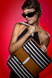 Modeling a Bag on Red Background Stock Photography