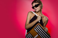 Modeling a Bag on Red Background Royalty Free Stock Photos