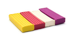 Modeling clay. Colorful bricks of modeling clay isolated against a white background Stock Photography