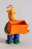 Modeling Clay Man with Box Stock Photography