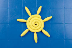 Modeling clay. Sun of modeling clay on a blue plastic table Stock Photos