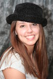 Modeling a hat. Teenage girl modeling a black hat Stock Photos