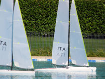 Modeling regatta. Two sailing boat, racing in a swimming pool Stock Image