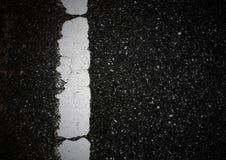Modell av asfalttextur med en linje royaltyfria bilder