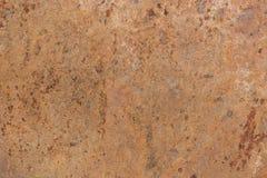 Modell av en stenplatta i ockran, beiga, brunt Arkivfoto