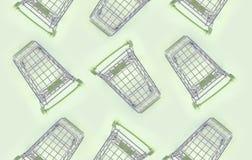 Modell av många små shoppa vagnar på en limefruktbakgrund arkivfoto