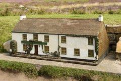 Modell av stugan på landslut 02, Cornwall Arkivfoton