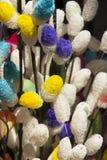 Modell bland flowerslen i vas Arkivbild