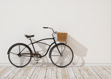 modell 3d av den svarta retro cykeln med korgen som är främst av den vita väggen, bakgrund Royaltyfri Bild