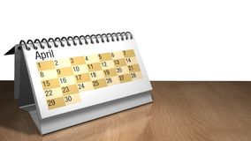 Modell 3D eines April-Tischplattenkalenders in der weißen Farbe auf einem Holztisch auf weißem Hintergrund Stockfoto
