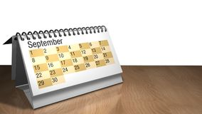 Modell 3D eines September-Tischplattenkalenders in der weißen Farbe auf einem Holztisch auf weißem Hintergrund Lizenzfreies Stockbild