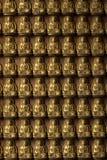 Modell för Buddhastatytegelplatta på väggen Royaltyfri Foto