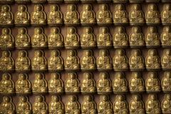 Modell för Buddhastatytegelplatta på väggen Arkivbilder