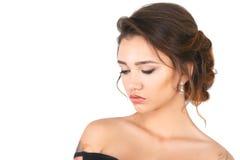 Modell för elegant kvinna för skönhetmode med makeup och hår på en vit bakgrund Arkivbild