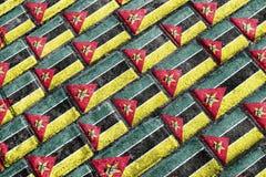 Modell för Grunge för Mocambique flagga stads- Arkivfoto