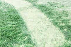 Modell för tyg för Closeupyttersidaabstrakt begrepp på den gröna tygmattan på golvet av hustexturbakgrund Royaltyfria Foton