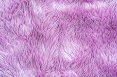 Modell för tyg för Closeupyttersidaabstrakt begrepp på den purpurfärgade tygmattan på golvet av hustexturbakgrund Royaltyfri Foto