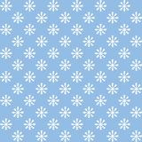 Modell för vita snöflingor för vektor sömlös på den blåa bakgrunden Vintergarnering Royaltyfria Bilder