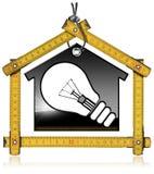 Modell House med en ljus kula och linjal Arkivfoton