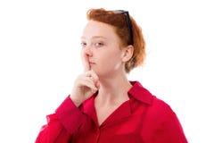 Modell lokalisiert mit dem Finger auf den Lippen geheim stockfoto