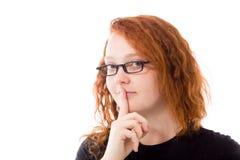Modell lokalisiert mit dem Finger auf den Lippen geheim stockfotos