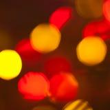 Modell med röda och gula bokehljus Fotografering för Bildbyråer