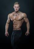 Modell mit Muskeln mit Tinte Stockfoto