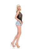 Modell som poserar, sidosikt Arkivfoto