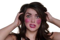 Modell trägt Lippenstift auf Backen Stockfotos