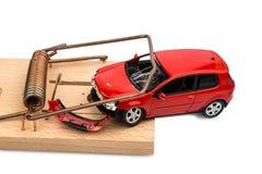 Modellauto in einer Mausefalle Lizenzfreie Stockfotos
