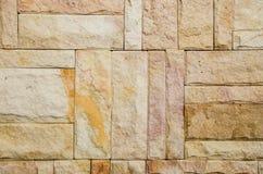Modellen av dekorativa bruna grå färger kritiserar yttersida för stenväggen Royaltyfri Fotografi
