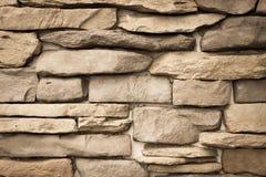 Modellen av dekorativt kritiserar stenväggen royaltyfri foto