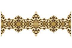 Modellen av den wood guld- blomman sned på trä royaltyfri fotografi