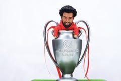 Modellera Figure Mohamed Salah med ligan för Uefa-mästare Trofhy royaltyfri foto