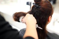 Modellera hårborsten Arkivbild