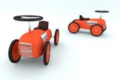 Röd bil för toy två på vitbakgrund Royaltyfria Foton