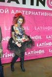 Modelli in costume esagerato con capelli rossi ed in stivali nel phot Immagine Stock Libera da Diritti
