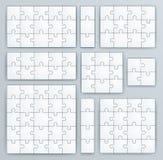Modelli del puzzle. Insieme dei pezzi di puzzle Fotografia Stock